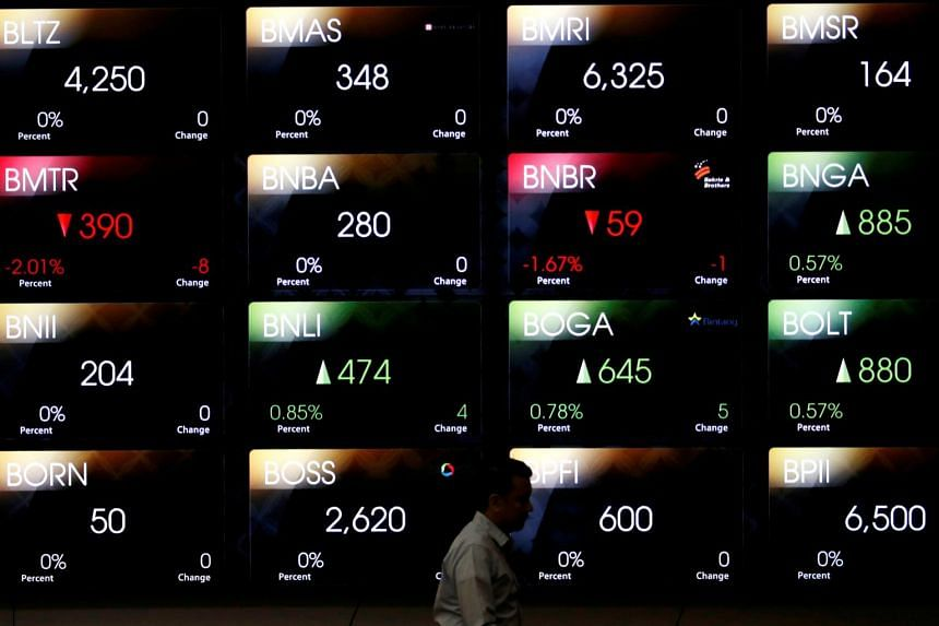 A man walks past a screen at the Indonesia Stock Exchange building in Jakarta, Indonesia, on Sept 6, 2018.