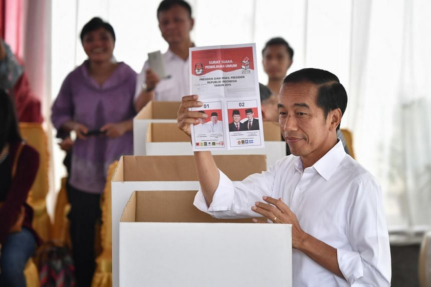 Incumbent President Joko Widodo (above) voting in Gambir, Jakarta, and his rival Prabowo Subianto casting his vote in Bogor, West Java, yesterday. The two men last contested the presidency in the 2014 elections, with Mr Joko defeating Mr Prabowo 53.1