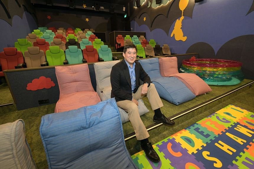 Shaw Organisation Mark Shaw (above) in the family-friendly Dreamers hall. Shaw Theatres Jewel's Lumiere halls feature premium reclining chairs.