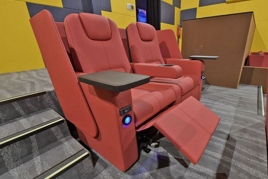 Shaw Organisation Mark Shaw in the family-friendly Dreamers hall. Shaw Theatres Jewel's Lumiere halls feature premium reclining chairs (above).