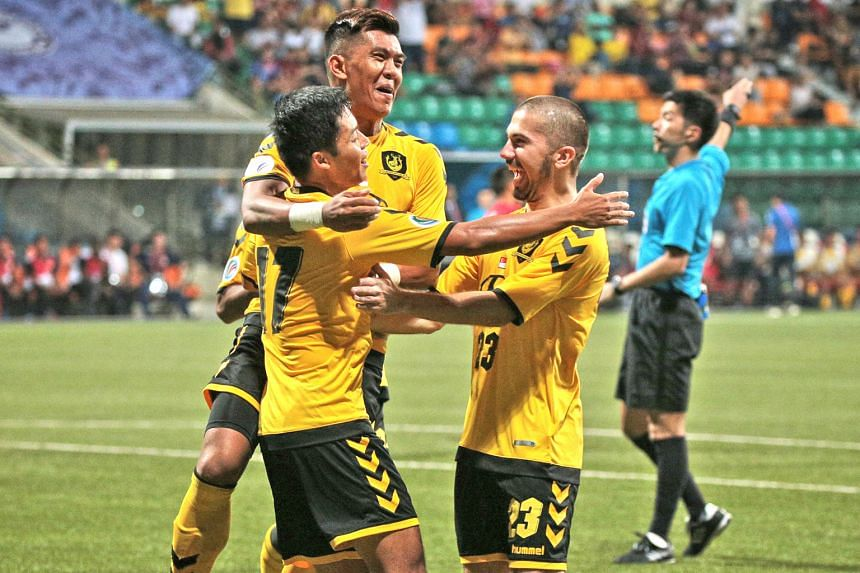 From left: Irwan Shah (left, celebrating with Khairul Amri and Zehrudin Mehmedovic) starting the ball rolling for Tampines Rovers with his third-minute opener against Cambodian club Nagaworld. The Stags won the AFC Cup Group F match 4-2 at the Jalan