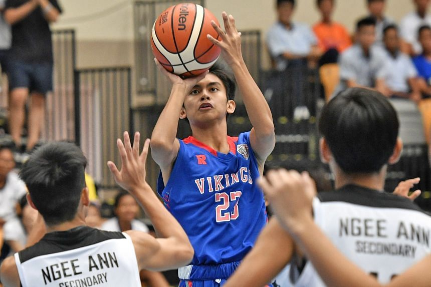 Yanoria Jayson Anthony Pizarra of North Vista Secondary School attempting a shot during the boys' B Division final against Ngee Ann Secondary School at Our Tampines Hub yesterday. Despite trailing after the first quarter, North Vista won 68-66 to cli