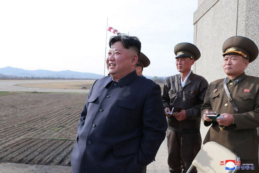 North Korean leader Kim Jong Un attends flight training for the Korean People's Army air force.