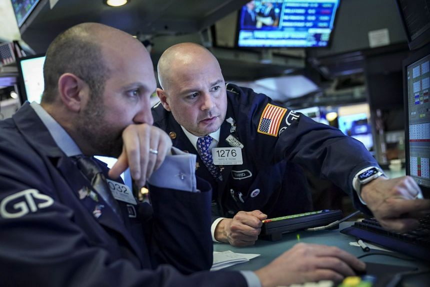 Traders work on the floor of the New York Stock Exchange in a file photo.