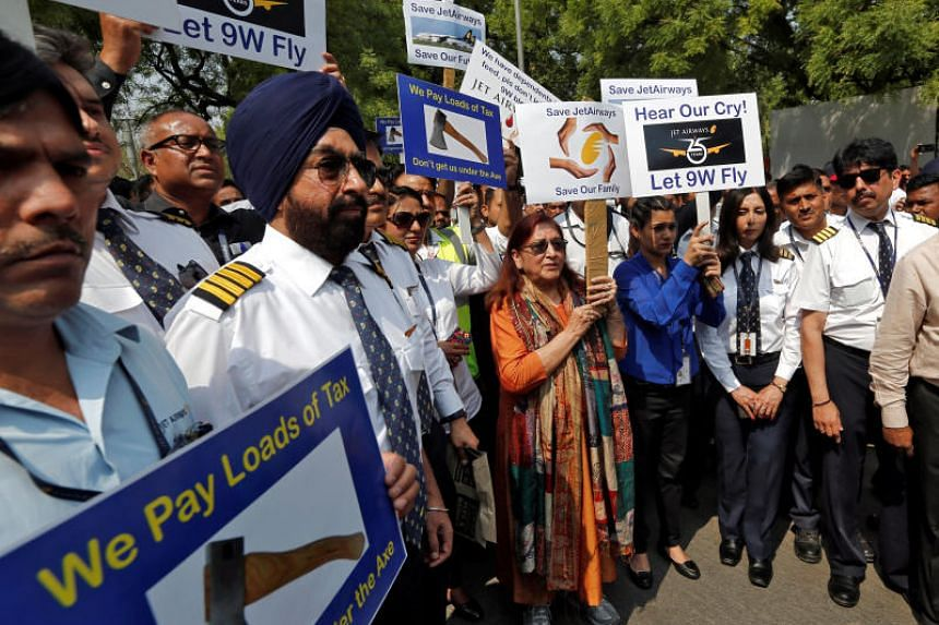 Jet Airways employees and their family members attend a protest demanding to save Jet Airways in New Delhi, India, April 18, 2019.
