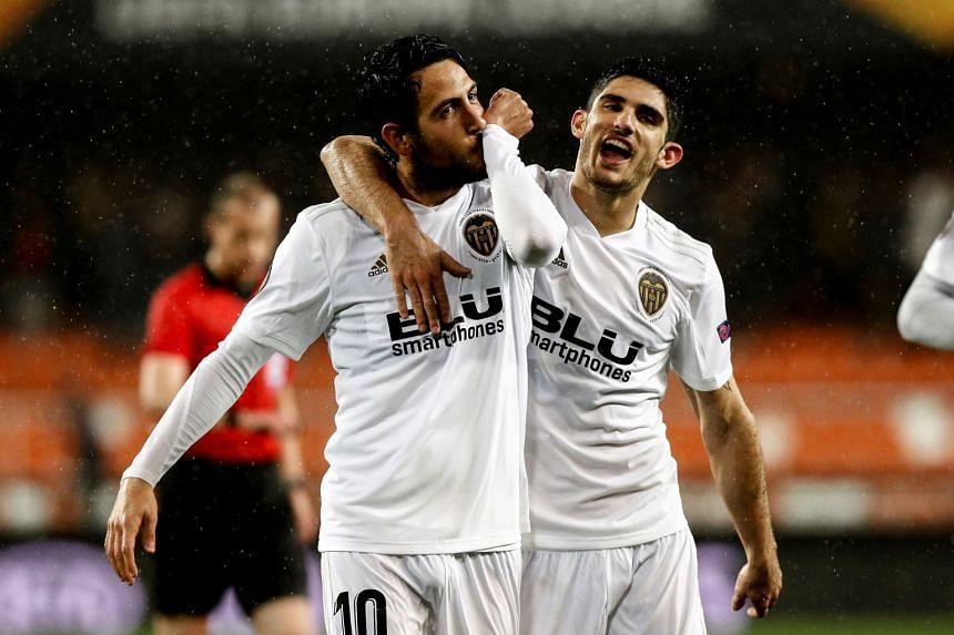 Valencia's Dani Parejo (left) celebrates with teammate Goncalo Guedes after scoring.