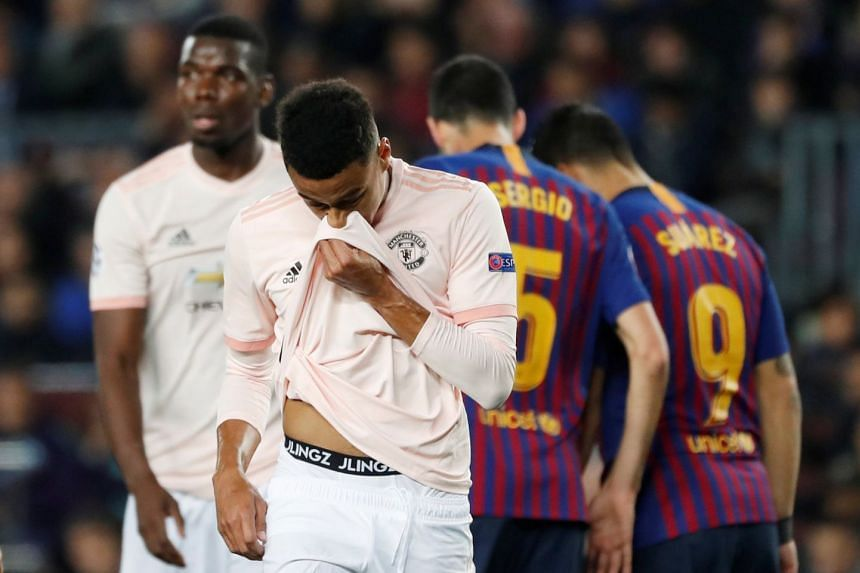 United's Jesse Lingard looks dejected during the match against Barcelona.