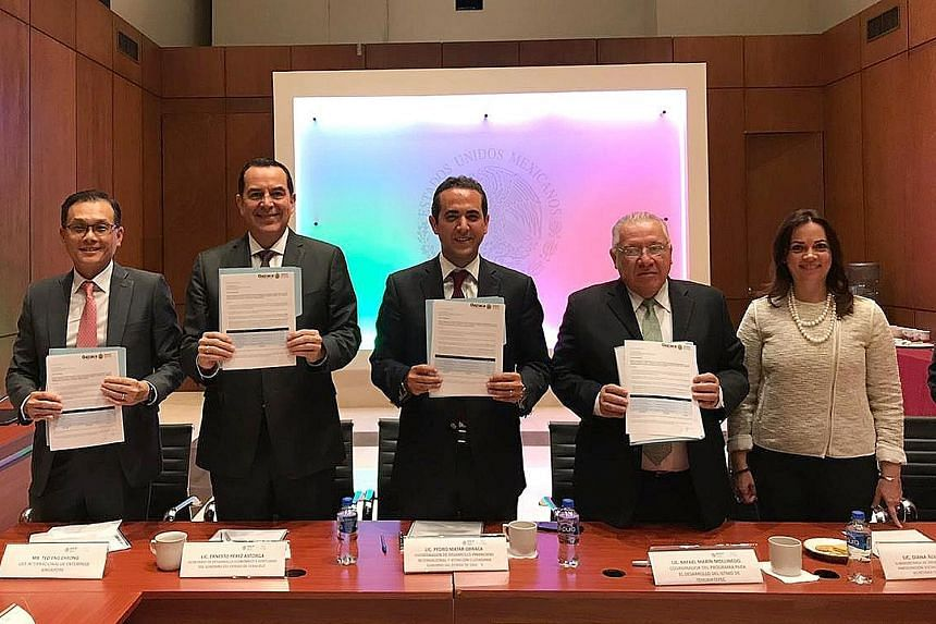 Surbana Jurong international chief executive Teo Eng Cheong (far left) with representatives from Mexico's state governments of Veracruz and Oaxaca, after signing the agreement to develop the inter-oceanic corridor. The company said it will also draw