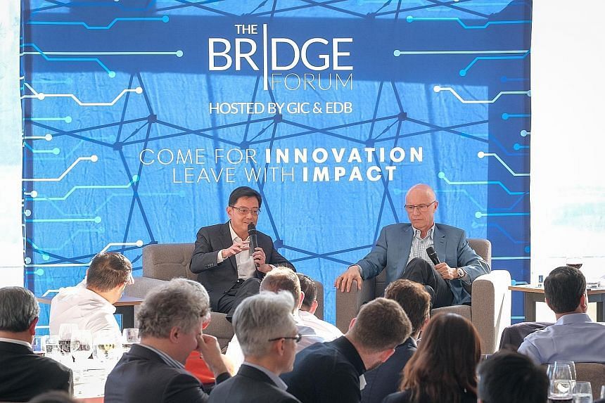 Finance Minister Heng Swee Keat, seen here with Sequoia Capital managing partner Doug Leone at the Bridge Forum CEO Summit in San Francisco on Wednesday, said he hoped Singapore can serve as Asia 101 for global companies seeking to get into Asia. PHO