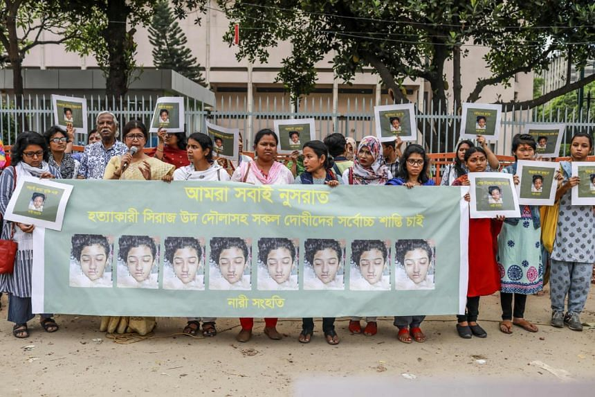 Bangladeshi women hold banners and photographs of schoolgirl Nusrat Jahan Rafi at a protest in Dhaka, on April 12, 2019.