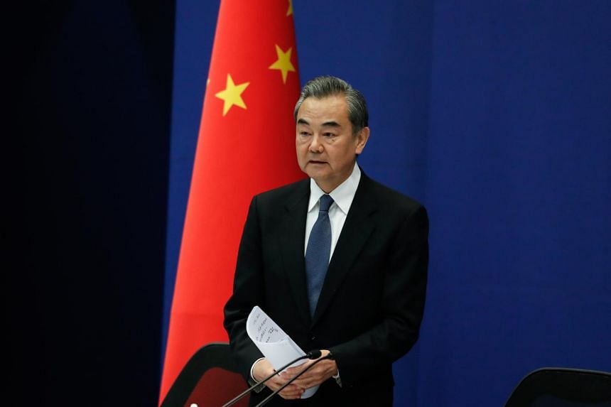 Chinese Foreign Minister Wang Yi arrives for the press briefing on the Second Belt and Road Forum for International Cooperation in Beijing on April 19, 2019.