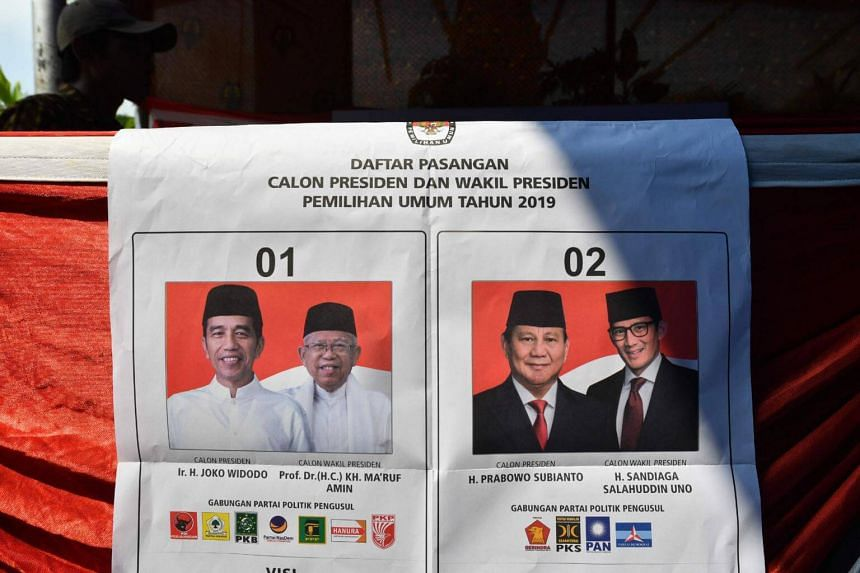 A poster of presidential candidates (from left) Mr Joko Widodo, his running mate Ma'ruf Amin, Mr Prabowo Subianto and his running mate Sandiaga Uno is seen at a polling station in Jakarta, on April 17, 2019.