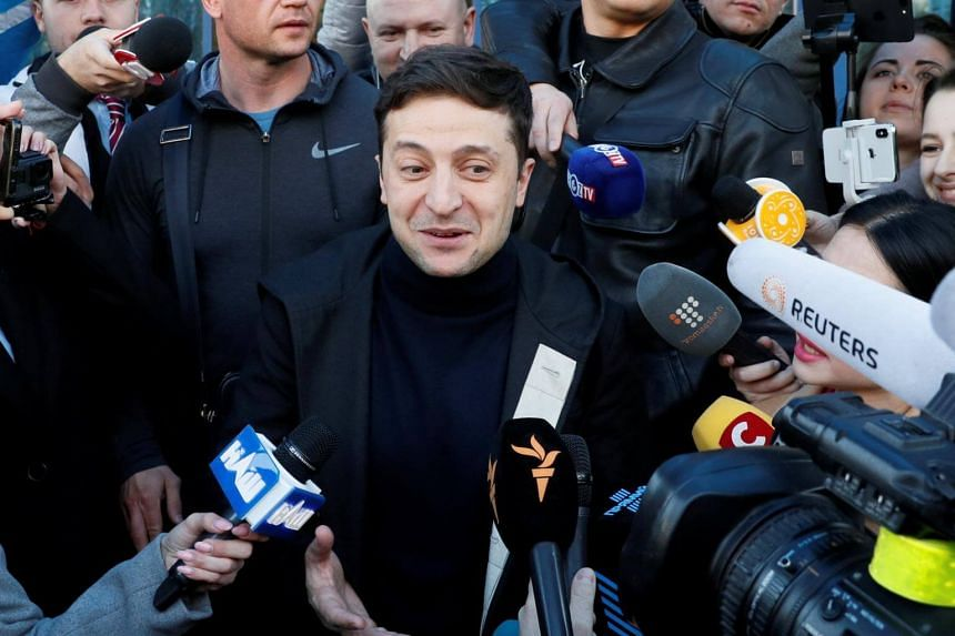 Ukrainian presidential candidate and comedian Volodymyr Zelenskiy (centre) speaks with journalists after undergoing a drugs and alcohol test, a precondition to participate in a policy debate ahead of the second round of a presidential election, outsi