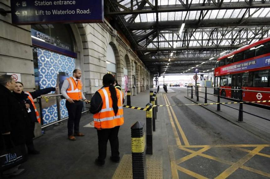 Security personel stand guard outside a police cordon at Waterloo Station, central London on March 5, 2019, following a report of a suspicious package at the station.