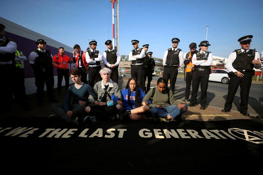 Climate change activists attend an Extinction Rebellion protest outside Heathrow Airport in London, Britain, on April 19, 2019.