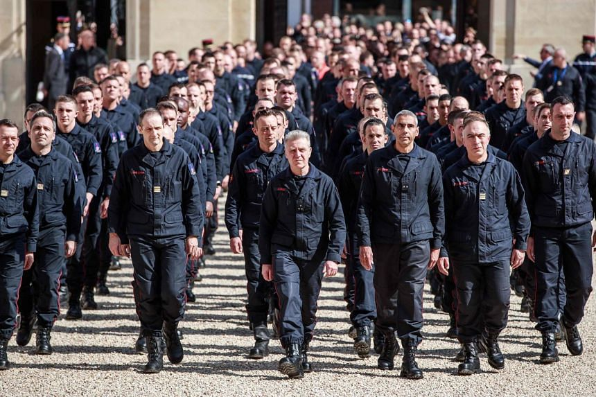Firefighters arrive at the Elysee palace before a meeting with the French president.