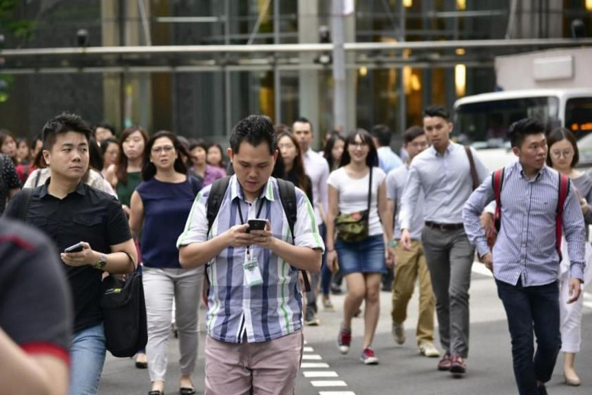 It would be more feasible to educate the population on the dangers of phone use while crossing the road, and appeal to them to be more sensible.