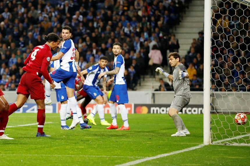 Defender Virgil van Dijk heading in the final goal to seal Liverpool's 4-1 Champions League quarter-final, second-leg win over Porto for a 6-1 aggregate victory at the Dragao Stadium in Porto on Wednesday night. PHOTO: REUTERS