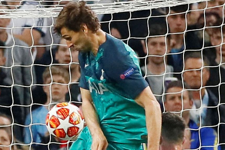 VAR DRAMA #2: Turkish referee Cuneyt Cakir signalling a VAR review, which cancelled out Raheem Sterling's late goal for offside. PHOTO: AGENCE FRANCE-PRESSE VAR DRAMA #1: Fernando Llorente about to score Spurs' crucial third goal, with the ball grazi
