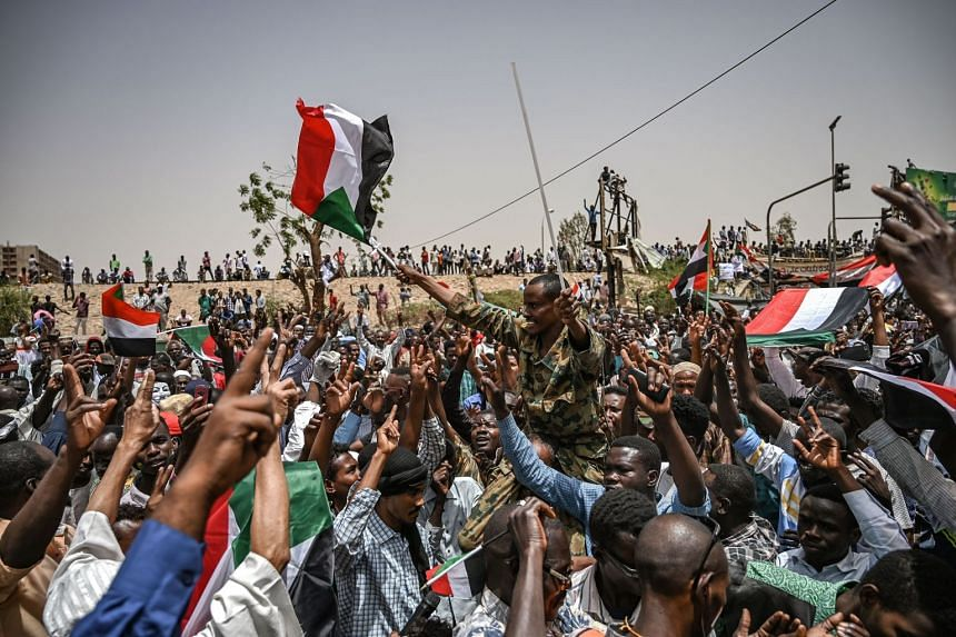 Sudanese protesters shout slogans outside the army complex in the capital Khartoum.