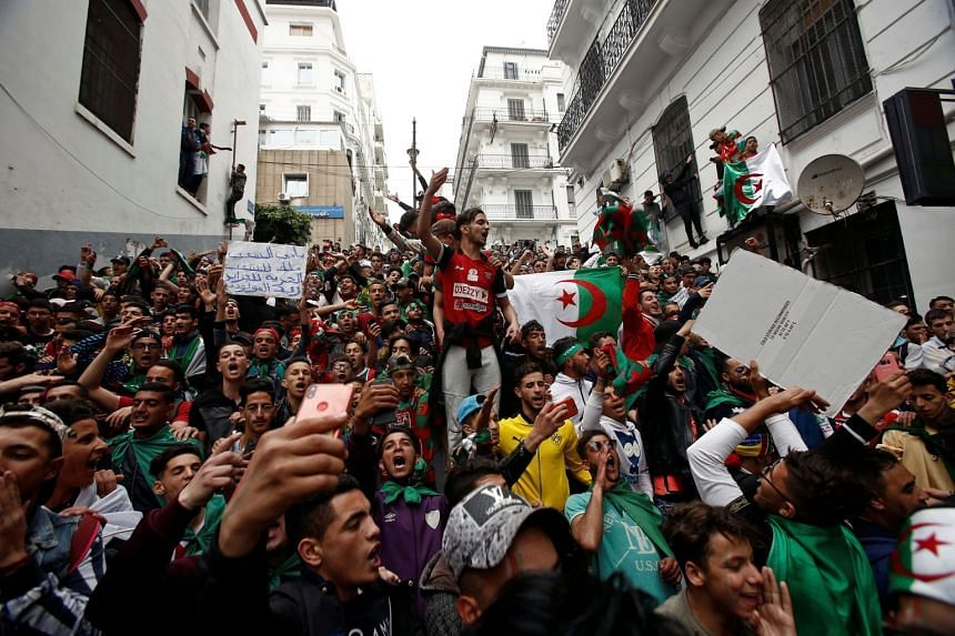 Protesters shout in Algiers as hundreds of thousands of demonstrators return to the streets in Algeria to press demands for wholesale democratic change.