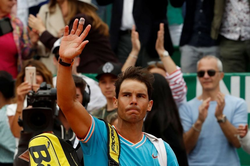 Nadal leaves the court after losing his semi-final match against Italy's Fabio Fognini.