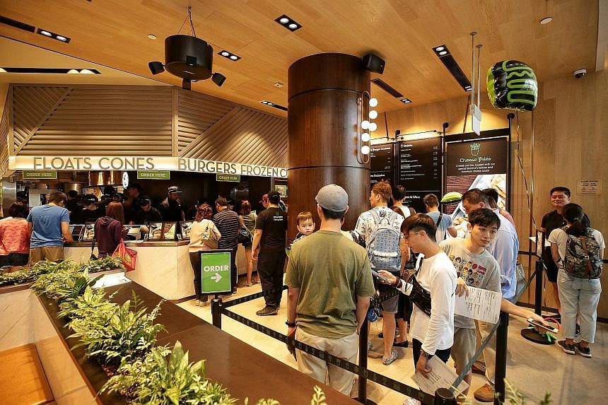 Customers queueing at Jewel Changi Airport's Shake Shack on Wednesday. Changi Airport is seeking to boost its position as an air hub of choice through Jewel to attract more stopover visitors and tourists as other airports in the region step up their