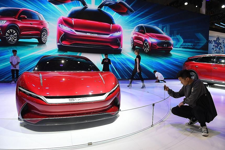 A visitor at the Shanghai Auto Show on Wednesday. The hottest topic among global carmakers at the show is tailoring cars to the needs of the booming ride-hailing and car-sharing services in China.