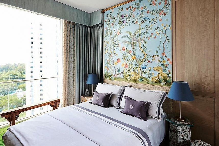 The bedroom features hand-painted silk wallpaper as well as porcelain garden stools that double as bedside tables.