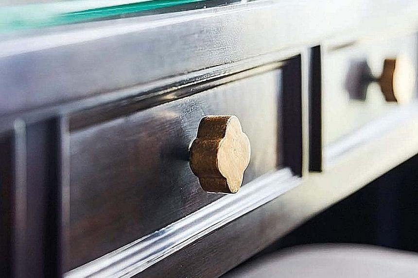 Drawer knobs take on the shape of plum blossoms, a recurring motif throughout the apartment.