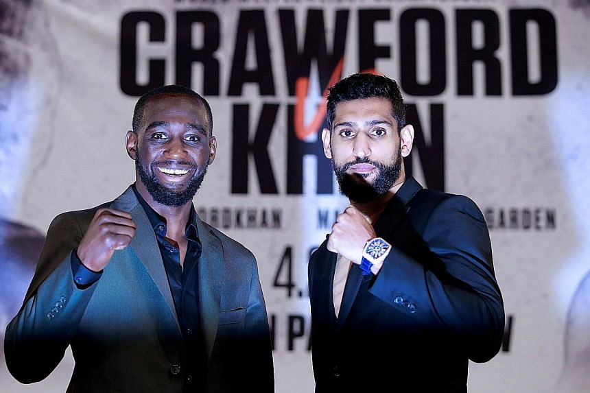 Terence Crawford and Amir Khan during their Wednesday press conference at New York's Madison Square Garden, where tonight's fight will take place. The 31-year-old American is putting his 34-fight unbeaten record on the line against the Briton, who is the