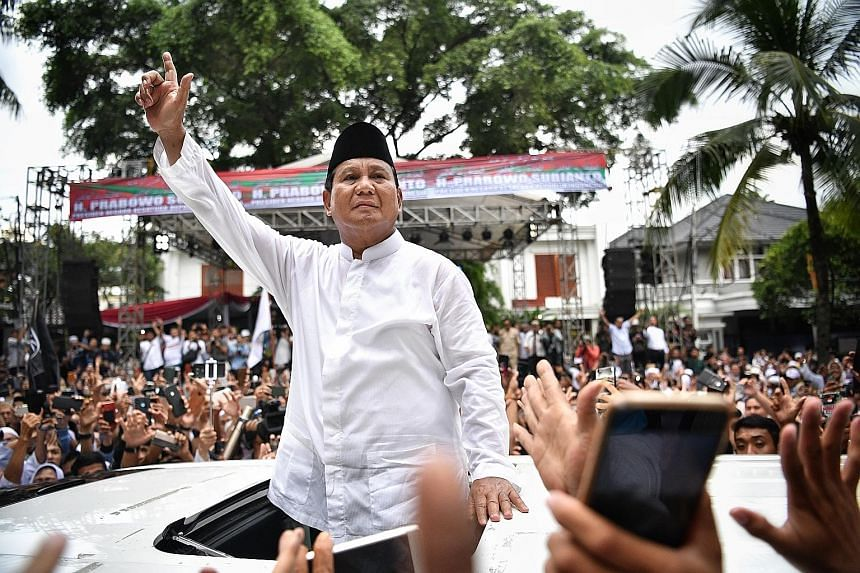 Indonesian presidential hopeful Prabowo Subianto meeting his supporters outside his home in South Jakarta yesterday. The gathering was organised by Mr Prabowo's supporters to mark the end of Wednesday's peaceful general election and for him to repeat