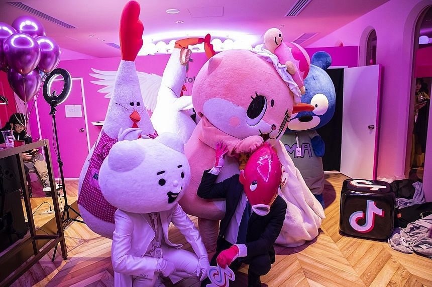 People dressed in costumes at a TikTok Creator's Lab event hosted by ByteDance in Tokyo in February. India banned TikTok, a popular video-sharing app, this week over concerns that it spread pornography and exposed children to sexual grooming.