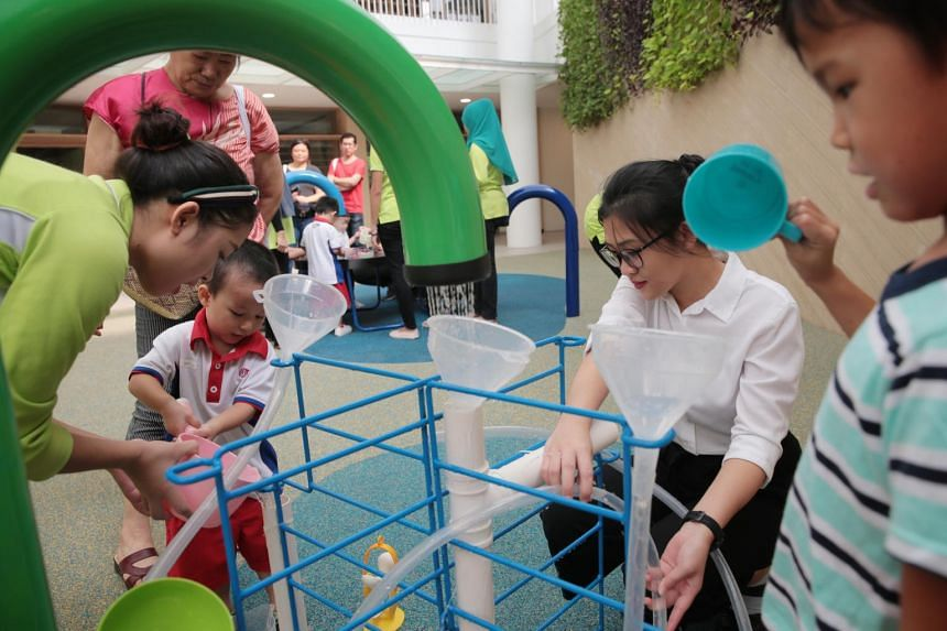 PCF Sparkletots @ Punggol North staff and students play at an outdoor play area during the centre's grand opening on April 20, 2019.