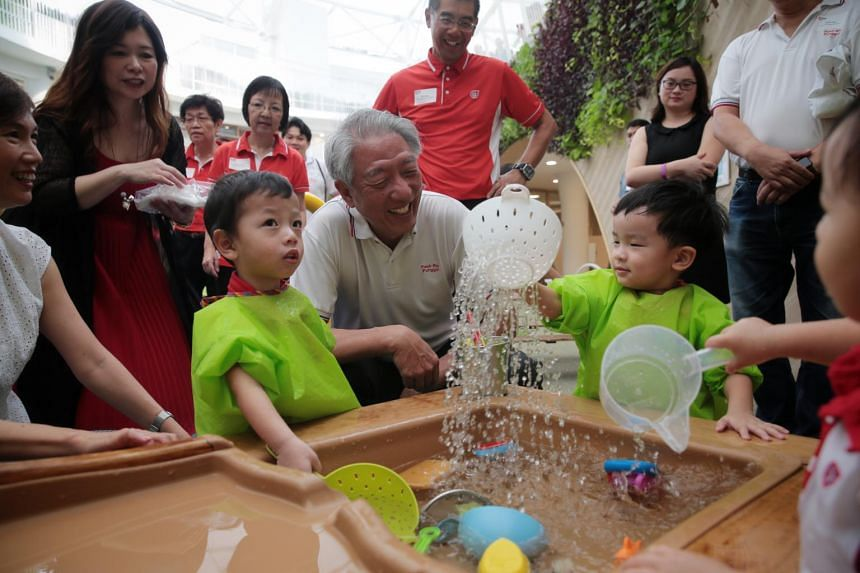 Deputy Prime Minister Teo Chee Hean interacts with PCF students Aaron Khoo, 2 (left), and Charles Ouyang Ming, 23 months (right), at PCF Sparkletots @ Punggol North Complex during its grand opening on April 20, 2019.
