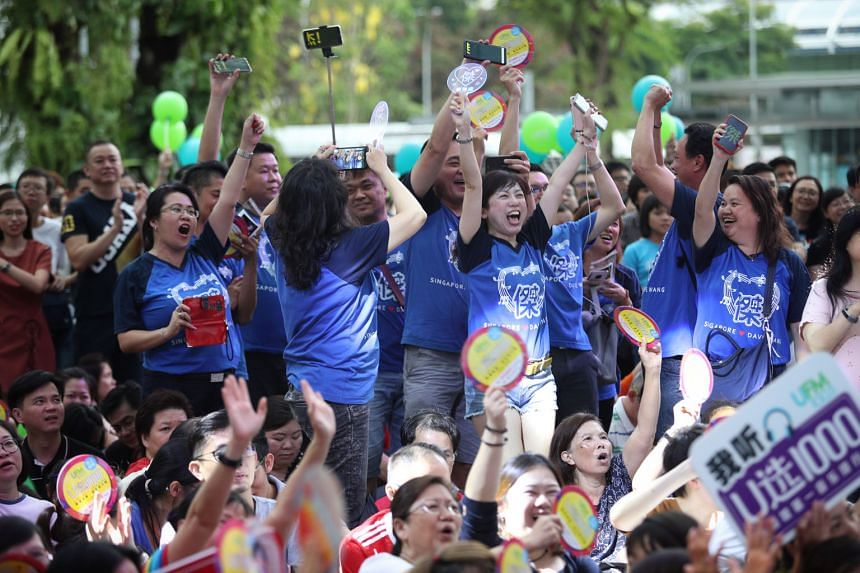 UFM100.3 listeners cheering the announcement of the U1000 Music Countdown Chart rankings.