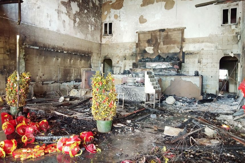 The front hall, prayer altar and 30 statuettes of the 80-year-old Poh Ann Keng Taoist temple in Tampines were badly damaged in a fire on Feb 9. The damage caused was estimated to be between $300,000 and $400,000.