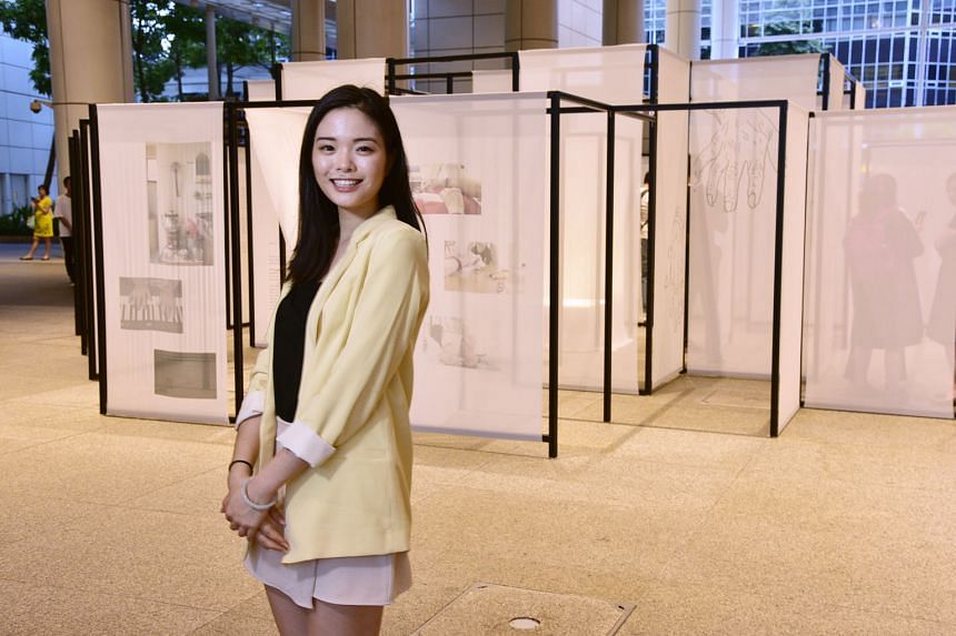 Visual artist Choo Jen Quinn next to her art installation, Piece Of Mind, at The Plaza in the National Library Building, in Victoria Street. The installation, which is supported by Thye Hua Kwan Moral Charities, the National Youth Council and SG Cares, wi