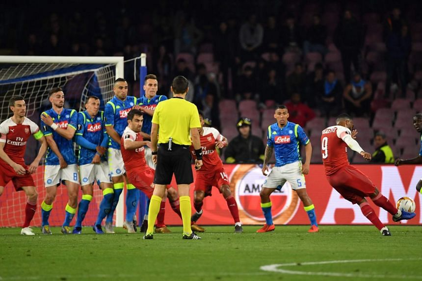 France striker Alexandre Lacazette seals the deal for Arsenal by scoring this free kick in their Europa League quarter-final, second leg against hosts Napoli on Thursday.