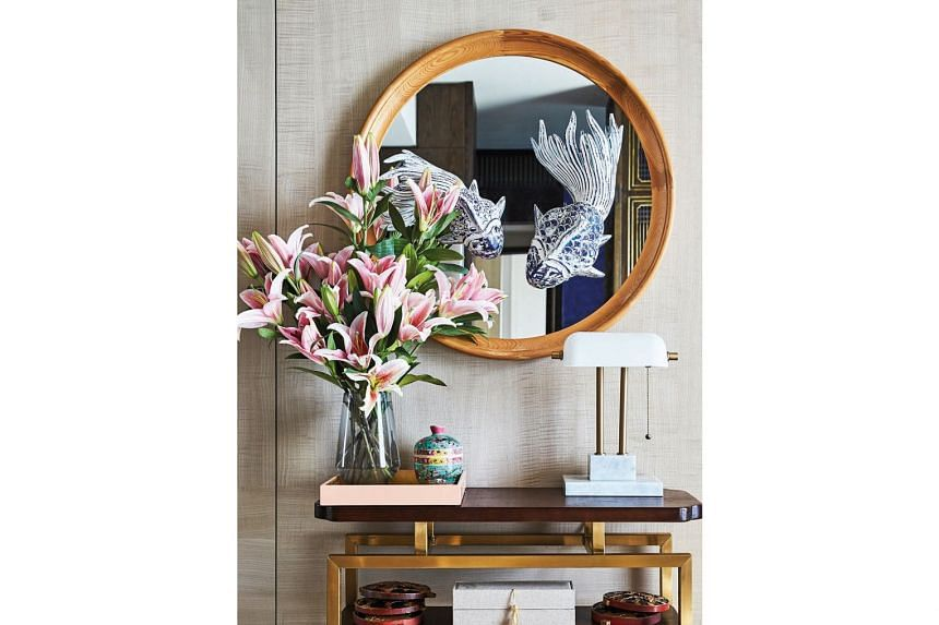 A D-I-Y mirror feature near the entrance foyer adds an interesting visual to the home.