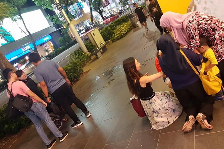 A small boy wearing a yellow shirt was hit by an e-scooter rider along the pedestrian walkway outside Orchard Shopping Centre on April 19.