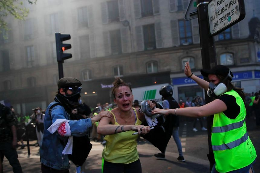A protester reacts during clashes at the Paris demonstration.