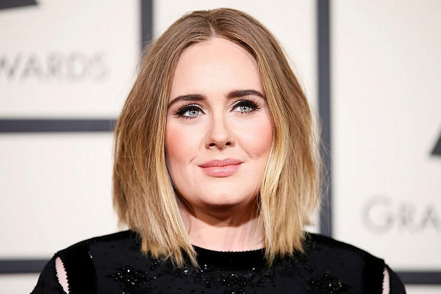 Singer Adele and ex-husband Simon Konecki will bring up their son together. PHOTO: REUTERS