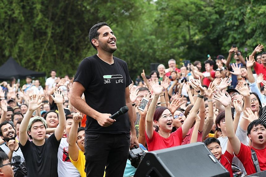 Popular vlogger Nuseir Yassin with his fans at the Botanic Gardens yesterday. Some 2,000 people turned up for the meet-and-greet with Mr Yassin and his girlfriend, fellow vlogger Alyne Tamir. Mr Yassin, whose Nas Daily page on Facebook has 12 million