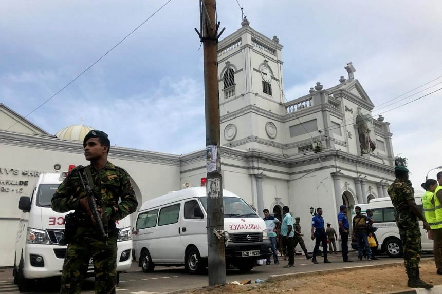Sri Lankan military officials stand guard in front of St Anthony's Church, Kochchikade church, after an explosion in Colombo, on April 21, 2019.
