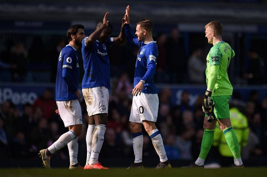 Everton players after their English Premier League football match against Arsenal at Goodison Park, on April 7, 2019.