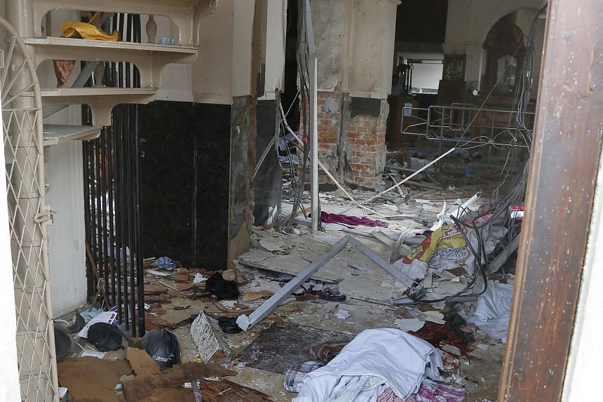 Debris is seen inside the damaged interior of St Anthony's Church in Kochchikade in Colombo, after the church was hit by an explosion on April 21, 2019.