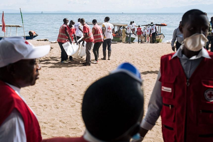 Red Cross volunteers load the bodies of people who were found after the accident on Lake Kivu.