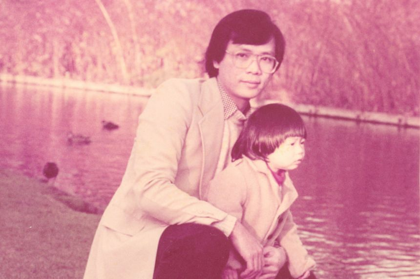 Left: Prof Kua's latest book, Speaking Up For Mental Illness, chronicles his decades of work in the field. Right: Prof Kua with his daughter Jade in Oxford in the 1980s. She is now a paediatric specialist.