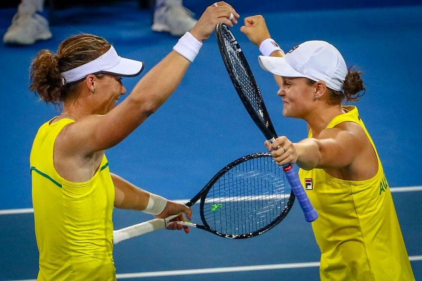 Samantha Stosur (left) and Ashleigh Barty celebrating Australia's 3-2 win over Belarus following their doubles victory in the Fed Cup tennis semi-finals at the Pat Rafter Arena in Brisbane on April 21, 2019.